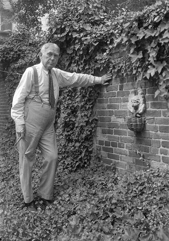 H.L. Mencken in his garden (1955)