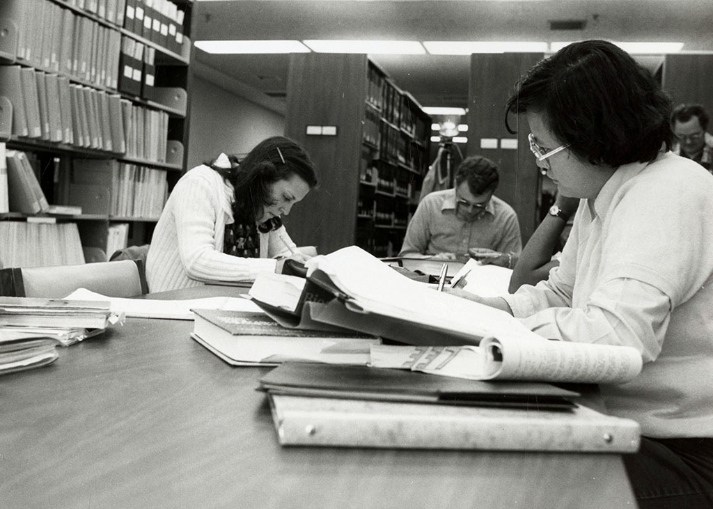 Students working at a table in the library
