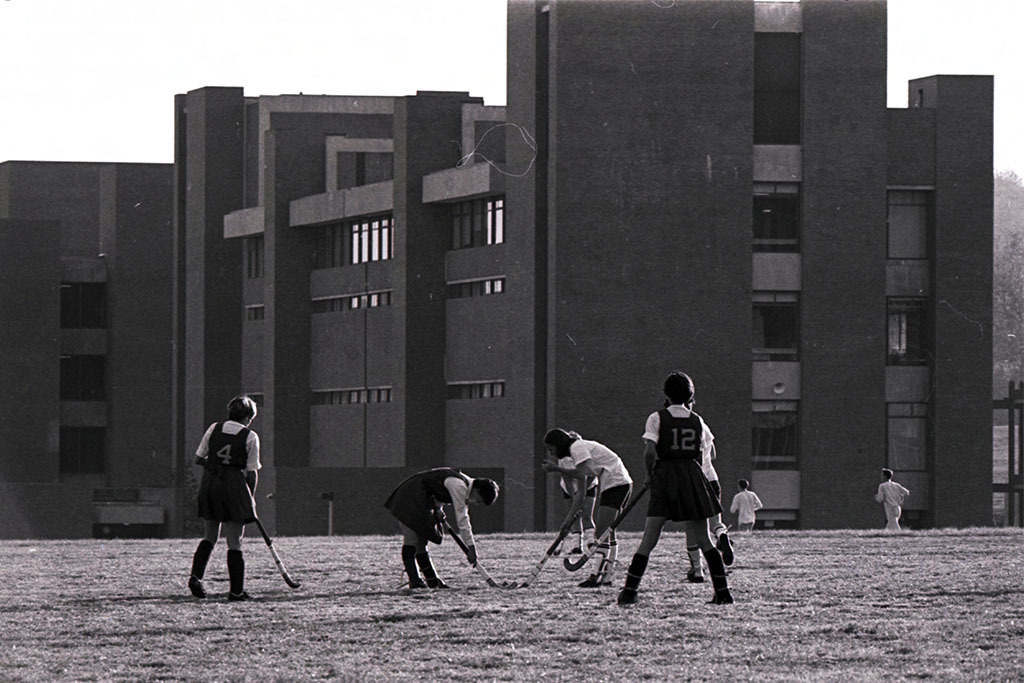 Women's Field Hockey game on the Library field