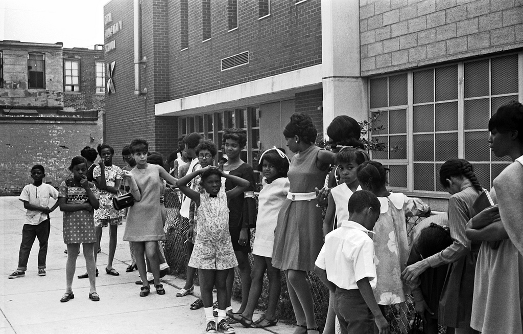 Children waiting in line outside Cecil Elementary School for tickets to the Johns Hopkins Hospital jazz concert, 1969.  [Langsdale Library, University of Baltimore](https://www.flickr.com/photos/ubarchives/4702884949/)